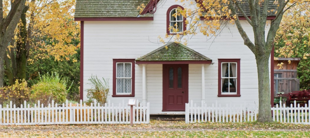 white tulsa house with red door