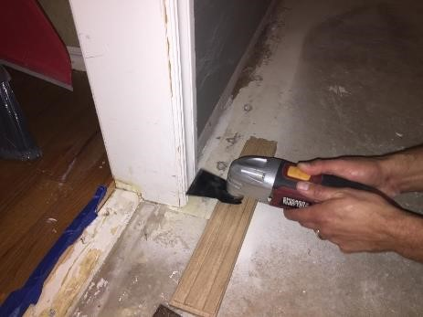 cut doorway trim for hardwood to fit beneath